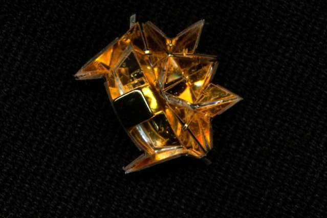 Centimeter-long origami robot climbs inclines, swims, and carries loads