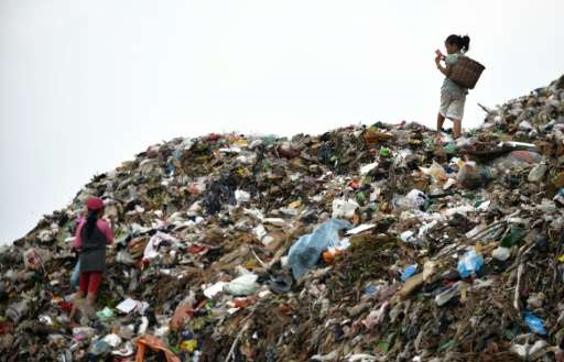 Child scavengers sort through a pile of waste at a dump area of Bantar Gebang, Bekasi districk, on the outskirts of Jakarta