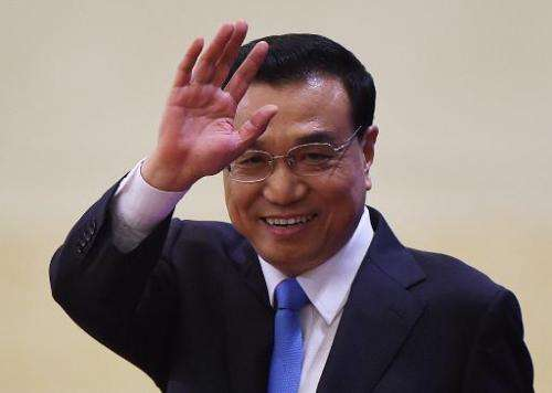 China's Premier Li Keqiang arrives for a press conference after the closing ceremony of the annual session of China's legislatur