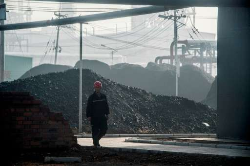 China will not improve on its pledges to control emissions, the country's top climate negotiator says