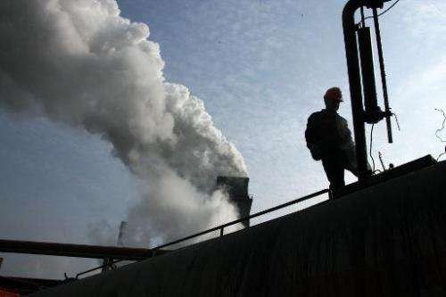 Chinese labourers work in a coal chemical factory in Huaibei, east China's Anhui province on August 14, 2013