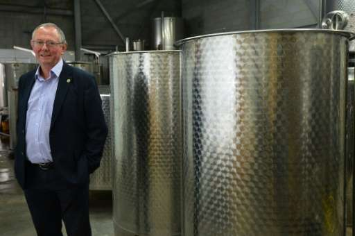 Chris Foss, Head of the Wine Department, poses for a photo in the storage area of the department, at Plumpton College in East Su