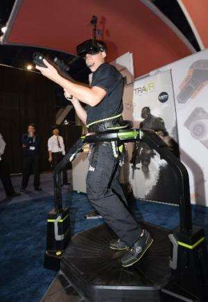 Christian Martin runs on the Virtuix Omni virtual reality treadmill that enables natural movement in 360 degrees in VR, wearing