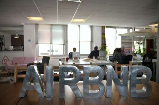 Employees of online lodging service Airbnb work in the Airbnb offices in Paris on April 21, 2015