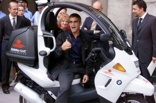 Even George Clooney, photographed in Milan on June 27, 2001, won't be allowed to drive a scooter in the city during new smog-res