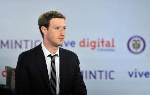 Facebook founder Mark Zuckerberg attends a meeting with Colombian President Juan Manuel Santos (out of frame) at Narino Presiden
