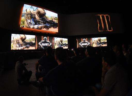"Fans watch a preview of the video game ""Call of Duty, Black Ops III"" ahead of the opening day of the Electronic Entert"