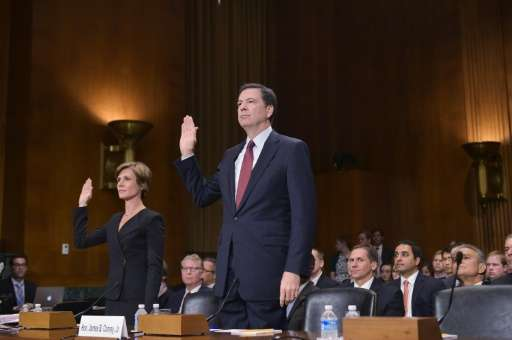 FBI Director James Comey (R) and Deputy Attorney General Sally Quillian Yates are sworn-in before the Senate Judiciary Committee