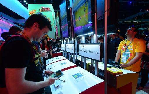Gaming fans play 'Mario & Luigi Paper Jam' on Nintendo 3DS at E3 - the Electronic Entertainment Expo - an annual video game