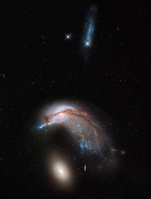 Image: Misshapen NGC 2936 galaxy