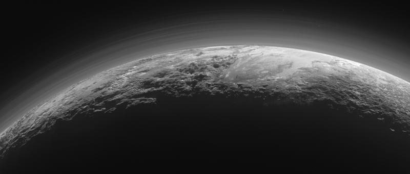 Image: Pluto's majestic mountains, frozen plains and foggy hazes