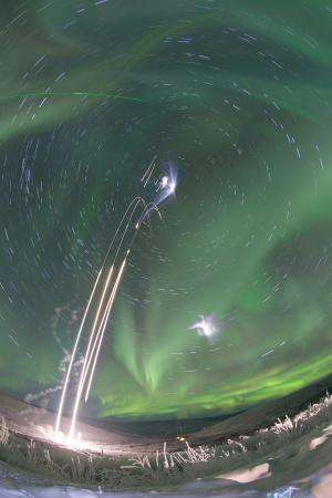 Image: Sounding rockets launch into an aurora
