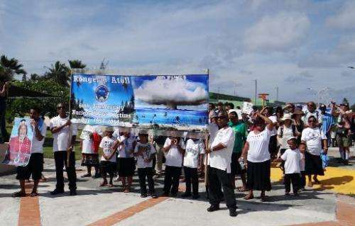 """Islanders from nuclear weapons test-damaged Rongelap Atoll march at a rally marking the 60th anniversary of the """"Bravo&quot"""
