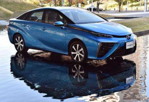 """Japanese auto giant Toyota Motor's fuel cell vehicle """"Mirai"""" is displayed in Tokyo on November 18, 2014"""