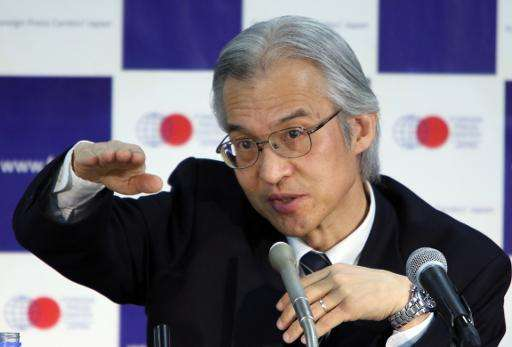 Joji Morishita, Japan's commissioner to the International Whaling Commission, speaks to the press in Tokyo on April 14, 2015