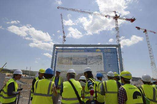 Journalists visit the construction site of the International Thermonuclear Experimental Reactor (ITER) in Saint-Paul-les-Durance