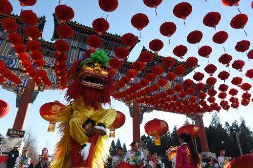 Lion dancers perform at the opening ceremony of the Ditan Park temple fair on the eve of the Lunar New Year in Beijing on Februa