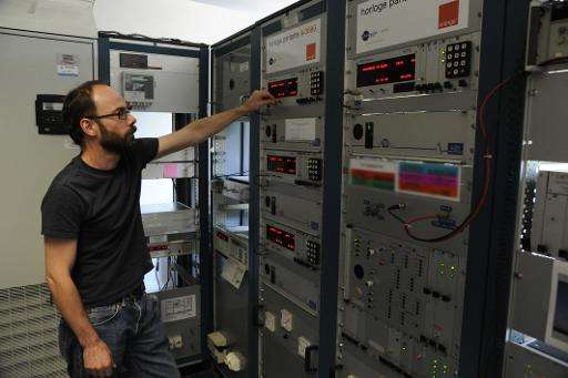 Michel Abgrall, head of national reference at part of the Paris Observatory, monitors a bank of equipment on June 12, 2015, in r