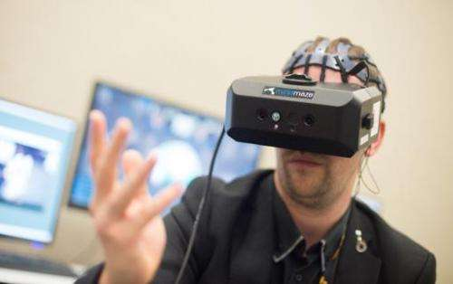 Mind Maze Software Engineer Nicolas Bourdaud demonstrates a virtual reality system at the Game Developers Conference in San Fran