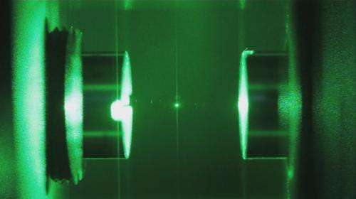 Nanospheres cooled with light to explore the limits of quantum physics