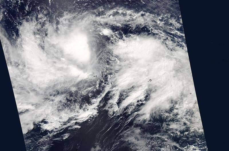 NASA sees 2 tropical cyclones on either side of the equator