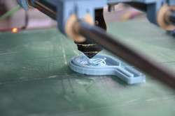 New lasers offer low cost industrial processing and novel surgical possibilities