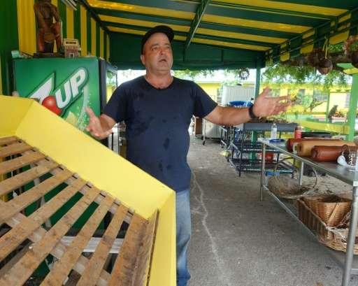 Noel Ruiz stands at his empty fruit stand in Redland, Florida on October 2, 2015
