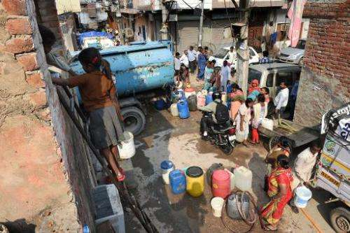 Resident of the working-class New Delhi suburb of Kailash Puri collect water from a tanker on March 16, 2015