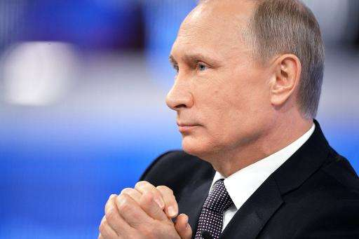Russian President Vladimir Putin listens takes part in an annual televised phone-in with the nation in central Moscow on April 1