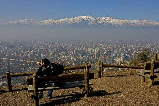 Santiago, a city of six million people, sits in an enclosed valley with limited wind and little rain to wash away the contaminat
