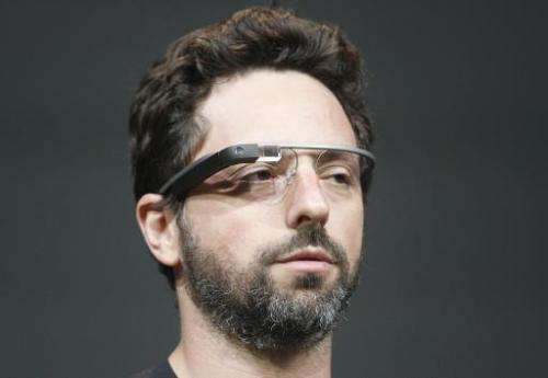 Sergey Brin, co-founder of Google, wears Google Glass as he speaks at the company's annual developer conference on June 27, 2012