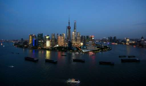Ships pass by the Lujiazui Financial District in Shanghai on August 14, 2015