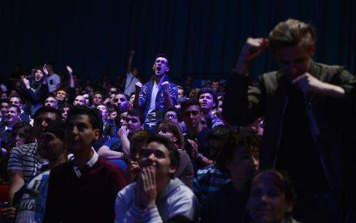 Spectators react during the Call of Duty Advanced Warfare Electronic Sports World Cup final, on May 3, 2015 in Paris