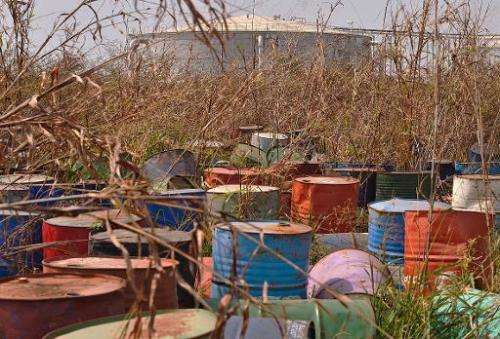 Steel barrels that used to store crude oil lie at an abandoned oil treatment facility at Thar Jath in Unity State, South Sudan,