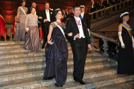 Sweden's Princess Sophia (L) and Nobel physics co-laureate Takaaki Kajita of Japan arrive for the 2015 Nobel Banquet at Stockhol