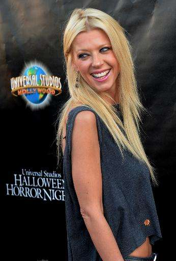 """Tara Reid, seen here in Los Angeles on September 19, 2014, has been a prize asset for """"Sharknado 2: The Second One"""" an"""