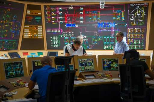 Technicians are pictured as they work on the simulator control panel during an exercise on nuclear security at the Civaux Nuclea