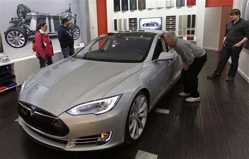 Tesla's 3Q loss widens, but shares rise on production