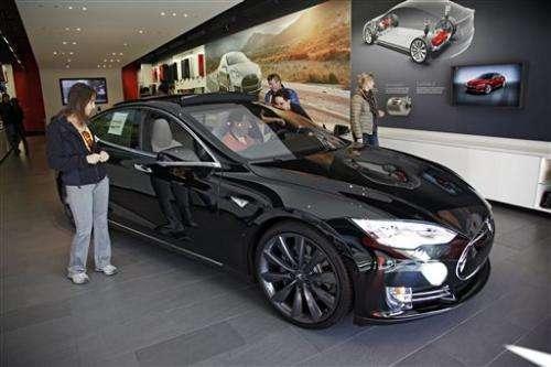 Tesla's 4Q profit falls on strong dollar, delayed shipments