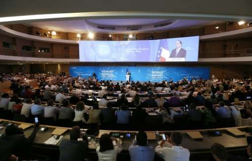 The audience listens to French president François Hollande during the World Summit - Climate and Territories in Lyon, on July 1,