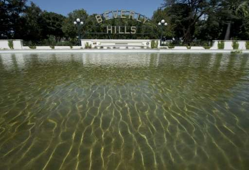 The Beverly Hills lily pond with the city's famous sign is seen during a severe drought in Beverly Hills, California on April 9,