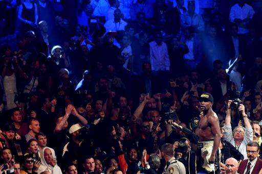 The crowd take smartphone photos of Floyd Mayweather as he celebrates his unanimous decision victory against Manny Pacquiao on M