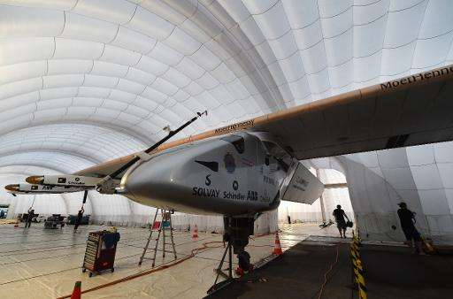 The pilot of a solar-powered plane trapped in Japan by the country's rainy season said Thursday he is prepared to wait two more