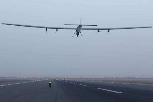 The solar-powered plane Solar Impulse 2 takes off from Muscat airport in Oman early on March 10, 2015, as it heads to Ahmedabad