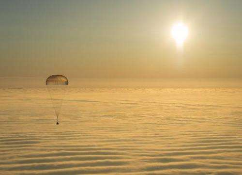 The Soyuz TMA-14M spacecraft is seen as it lands with Expedition 42 commander Barry Wilmore of NASA, Alexander Samokutyaev of th