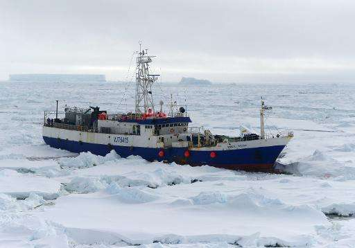 The US Coast Guard Cutter Polar Star begins breaking up the ice around a stranded Australian fishing vessel northeast of McMurdo