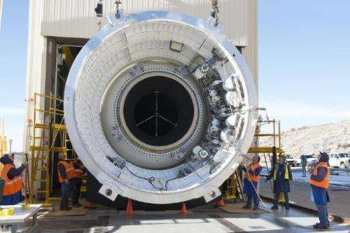 This NASA photo shows engineers at Orbital ATK preparing to test the most powerful booster ever built for NASA's new rocket, the