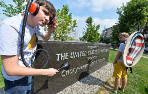 """Ukrainian Internet Party activists hold a """"tap the phone and internet lines"""" protest on June 27, 2013 outside the US E"""
