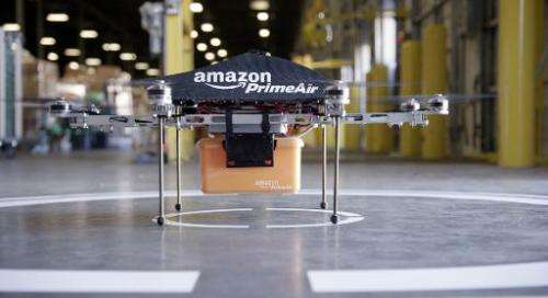 """Undated handout photo released by Amazon shows an """"octocopter"""" mini-drone that would be used to fly small packages to"""