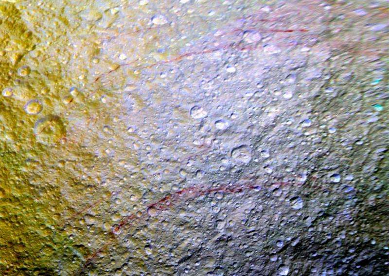 Unusual red arcs spotted on icy Saturn moon